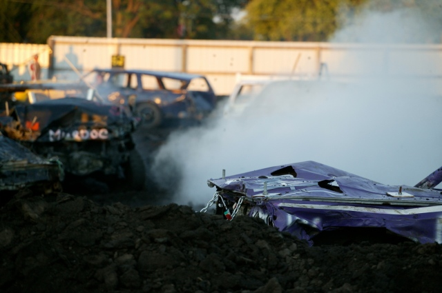 Photograph of a demolition derby in progress; part of the frame is filled with opaque white smoke