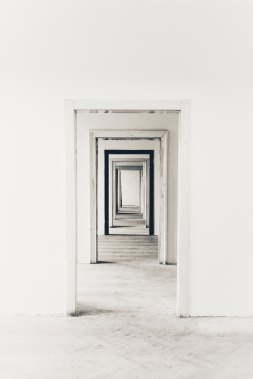 A picture of an endless series of open doorframes proceeding away from the view towards the center of the image
