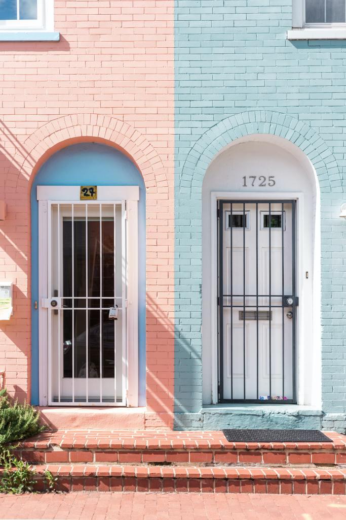 Two locked doors outside a duplex